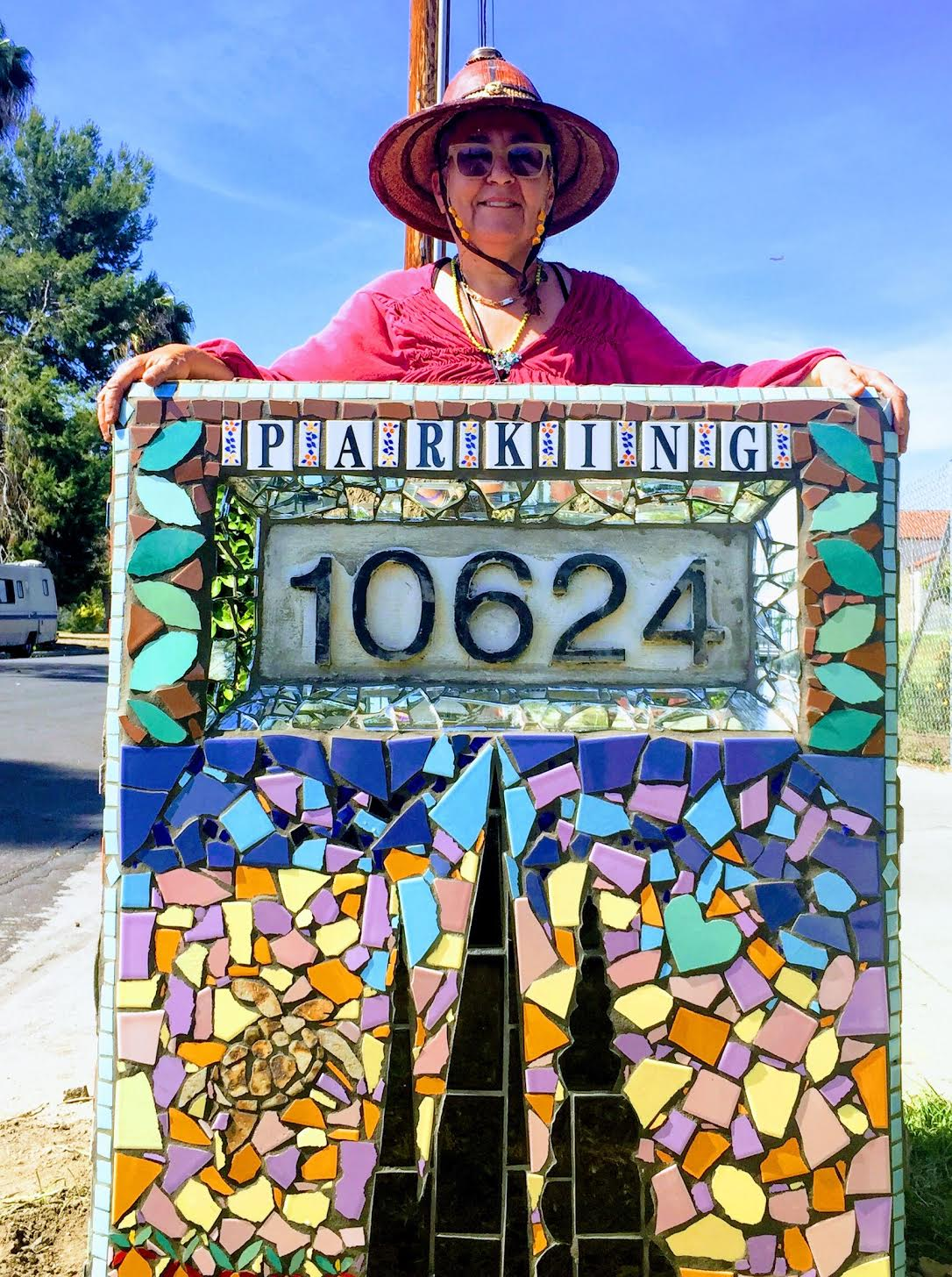 Mosaic at the entrance to the Watts Towers Arts Center completed April 2016. Materials include recycled tile, shell and glass pieces.